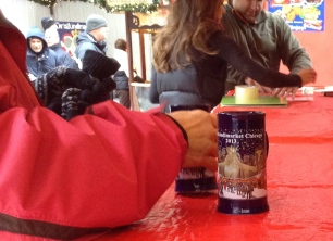 Nov. 26, 2013, Chicago – This year the souvenir mug is a tall, skinny, navy mug with the striped roof scene of the Christkindlmarket. (Alix Hines/Medill)