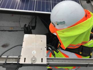 GRID Alternatives installs solar panels on single-family and multi-family homes. (Alix Hines/CIRCA)